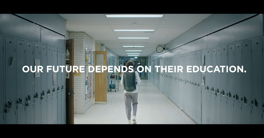 """Student in Hallway with the words """"Our Future Depends on Their Education"""""""